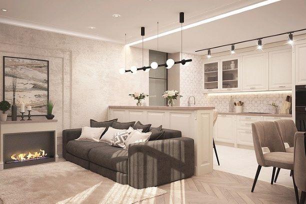 キッチン、ソファー、テーブルが置いてあるステキなマンションの一室の写真