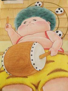 絵本「ピカゴロウ」の主人公のカミナリ様の男の子が太鼓をたたいて雲を呼んでいる絵